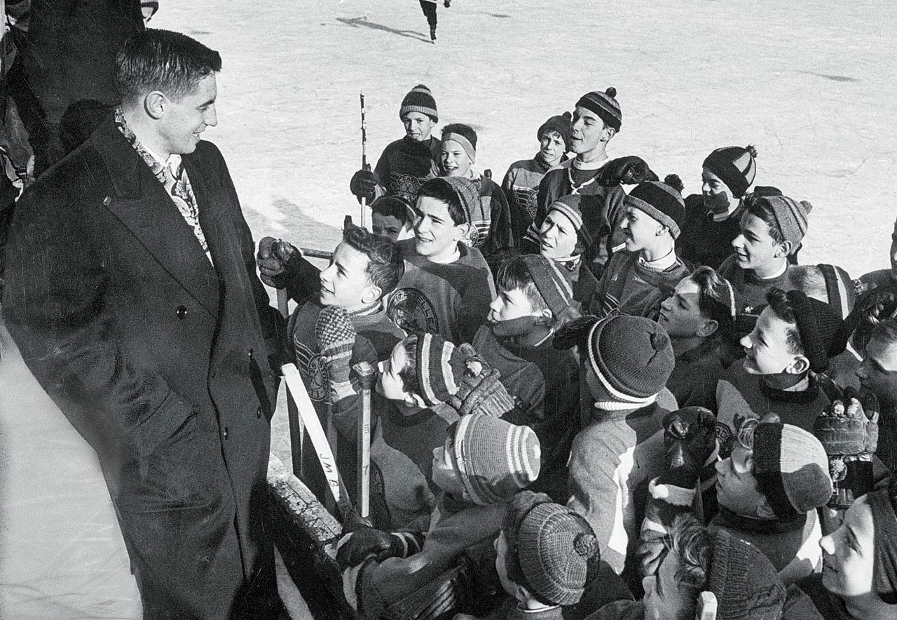 Jean Béliveau greets young fans at an outdoor skating rink in Dec. 1952.