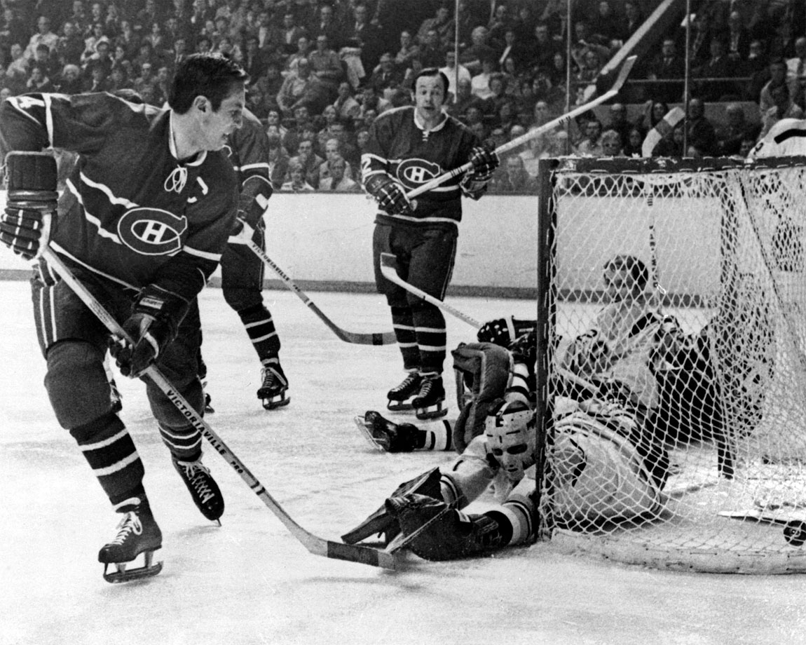 Jean Béliveau scores on Bruins goalie Eddie Johnston as Beliveau's teammate Yvan Cournoyer (12) looks on during Game 2 of the Stanley Cup Quarterfinals in Boston on April 8, 1971.