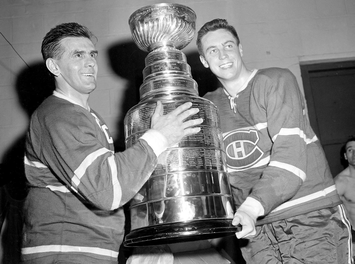 Jean Béliveau and Maurice Richard (left) smile in the dressing room with the Stanley Cup after defeating the Boston Bruins 5-3 in Game 6 of the Stanley Cup Finals at the Boston Garden on April 20, 1958.