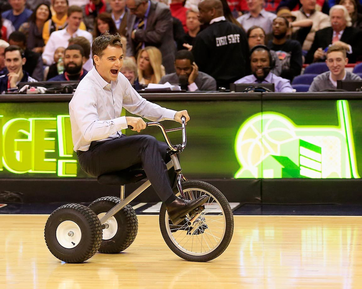 NASCAR (and tricycle) driver Jeff Gordon takes a spin during a contest on the court during a timeout in the Washington Wizards and San Antonio Spurs game.