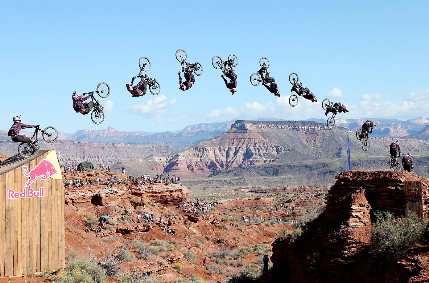 Jeff Herbertson backflips over the canyon gap during the Red Bull Rampage finals.