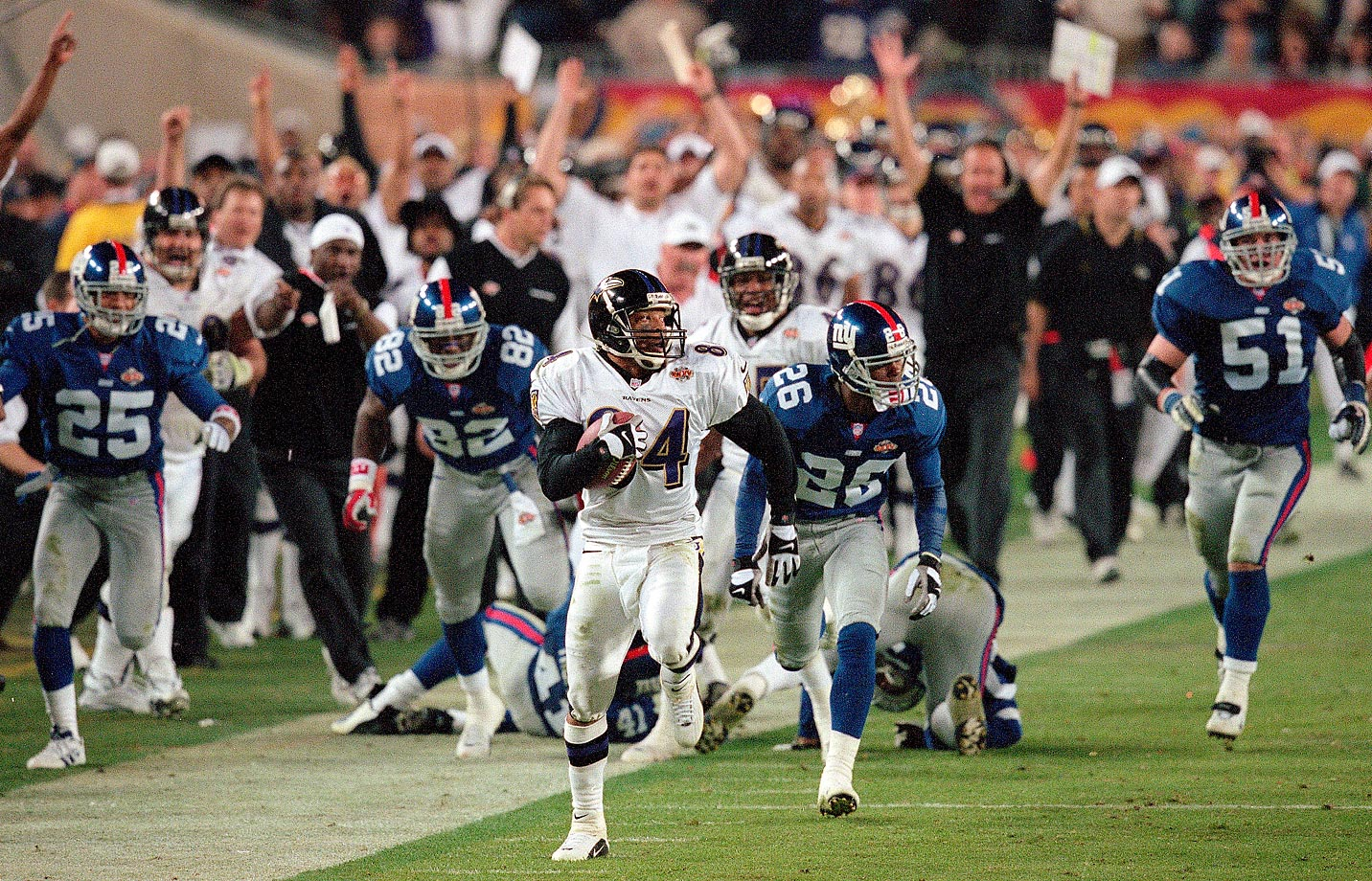 Baltimore's Jermaine Lewis returns a kickoff for a touchdown against the New York Giants in Super Bowl XXXV in January 2001.