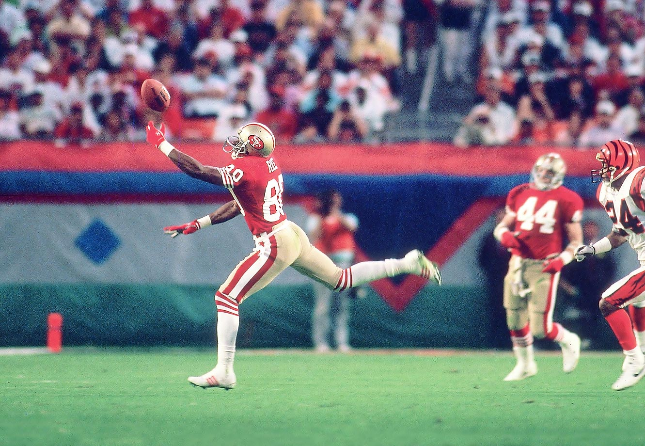 San Francisco 49ers wideout Jerry Rice stretches to catch a pass with one hand against the Cincinnati Bengals in January 1989.