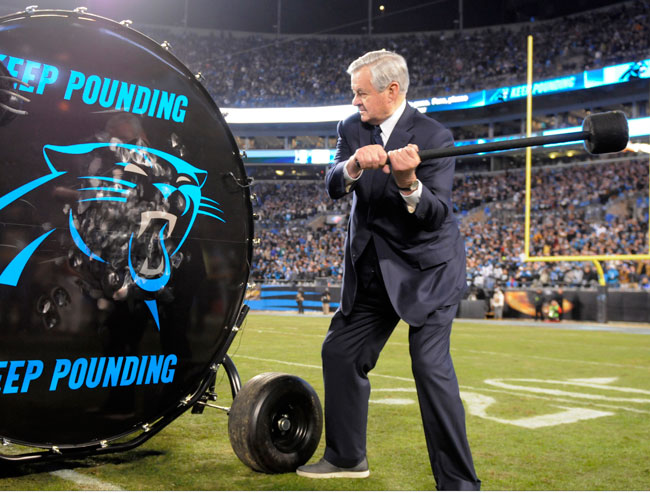 Panthers owner Jerry Richardson bangs the Keep Pounding drum before the NFC title game.