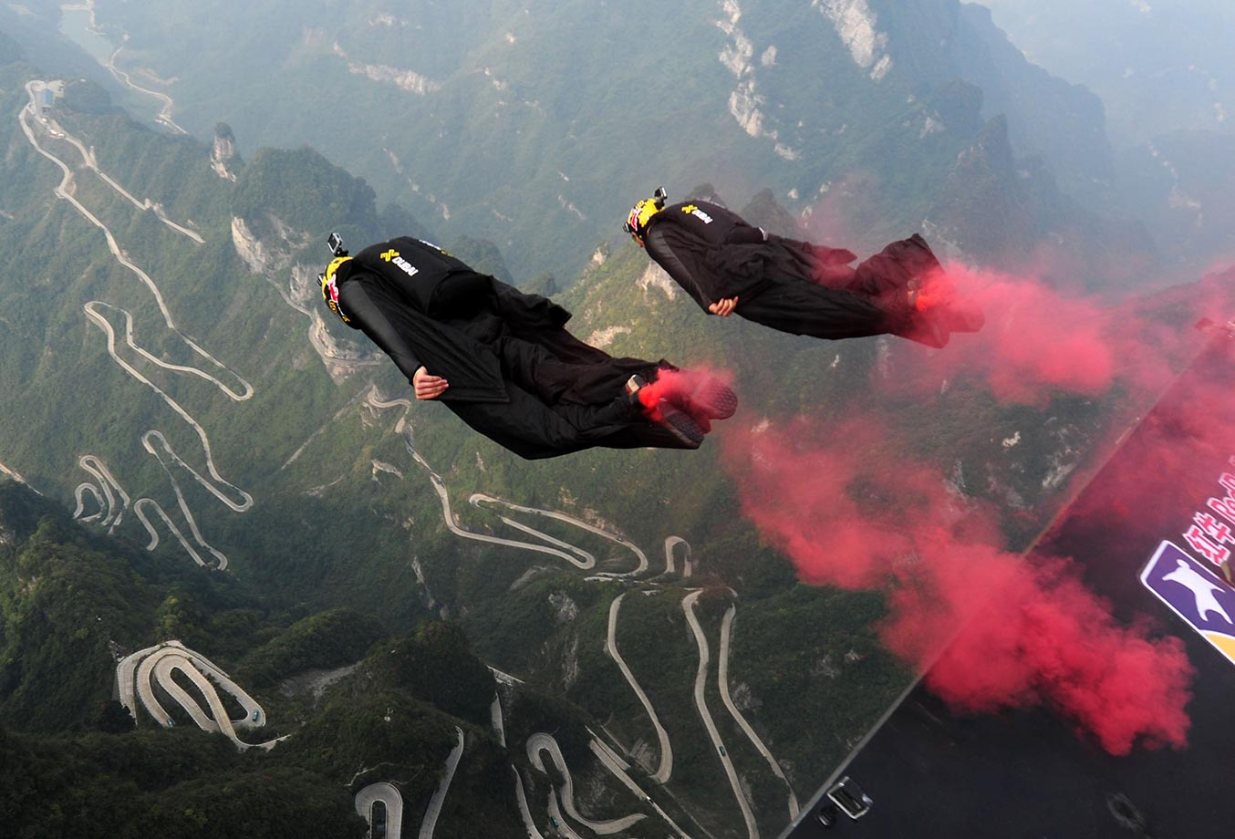 Wingsuit jumpers take off from the Tianmenshan scenic spot during the Fourth International Wingsuit Campaign in China.