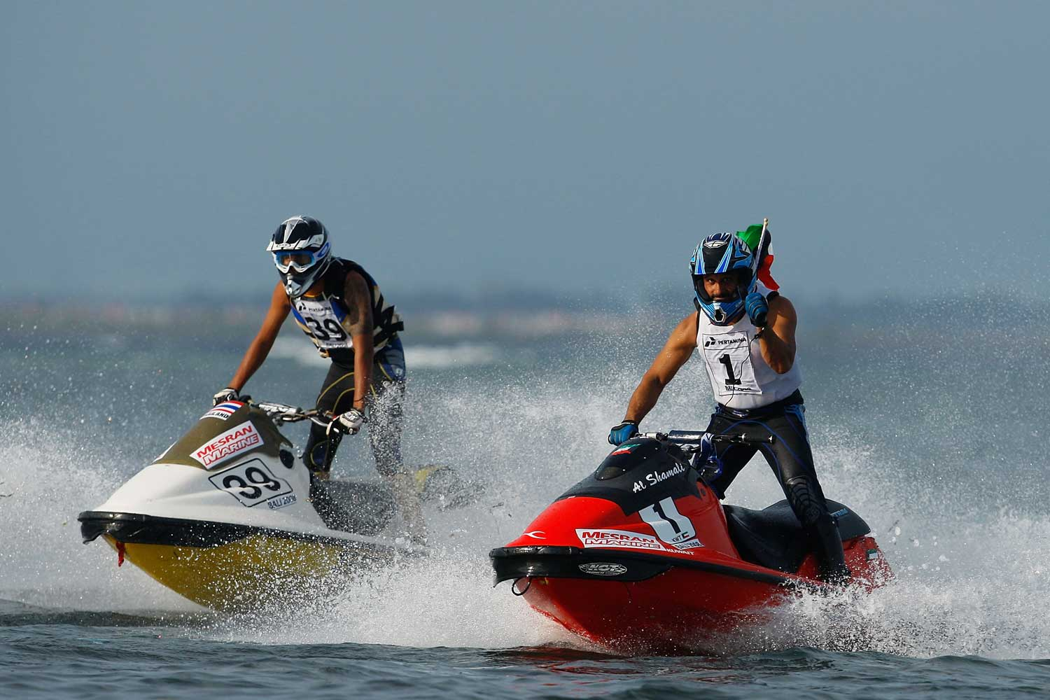 Jet skiers race to the finish in the Asian Beach Games at Nusa Dua in Bali, Indonesia.