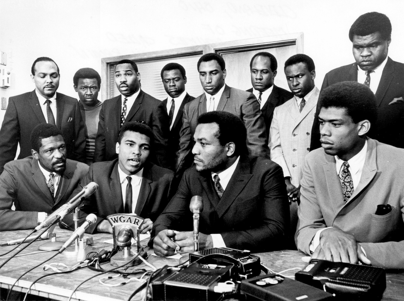 Jim Brown, Kareem Abdul-Jabbar, Bill Russell and other black athletes gather to support Muhammad Ali's refusal to fight in Vietnam