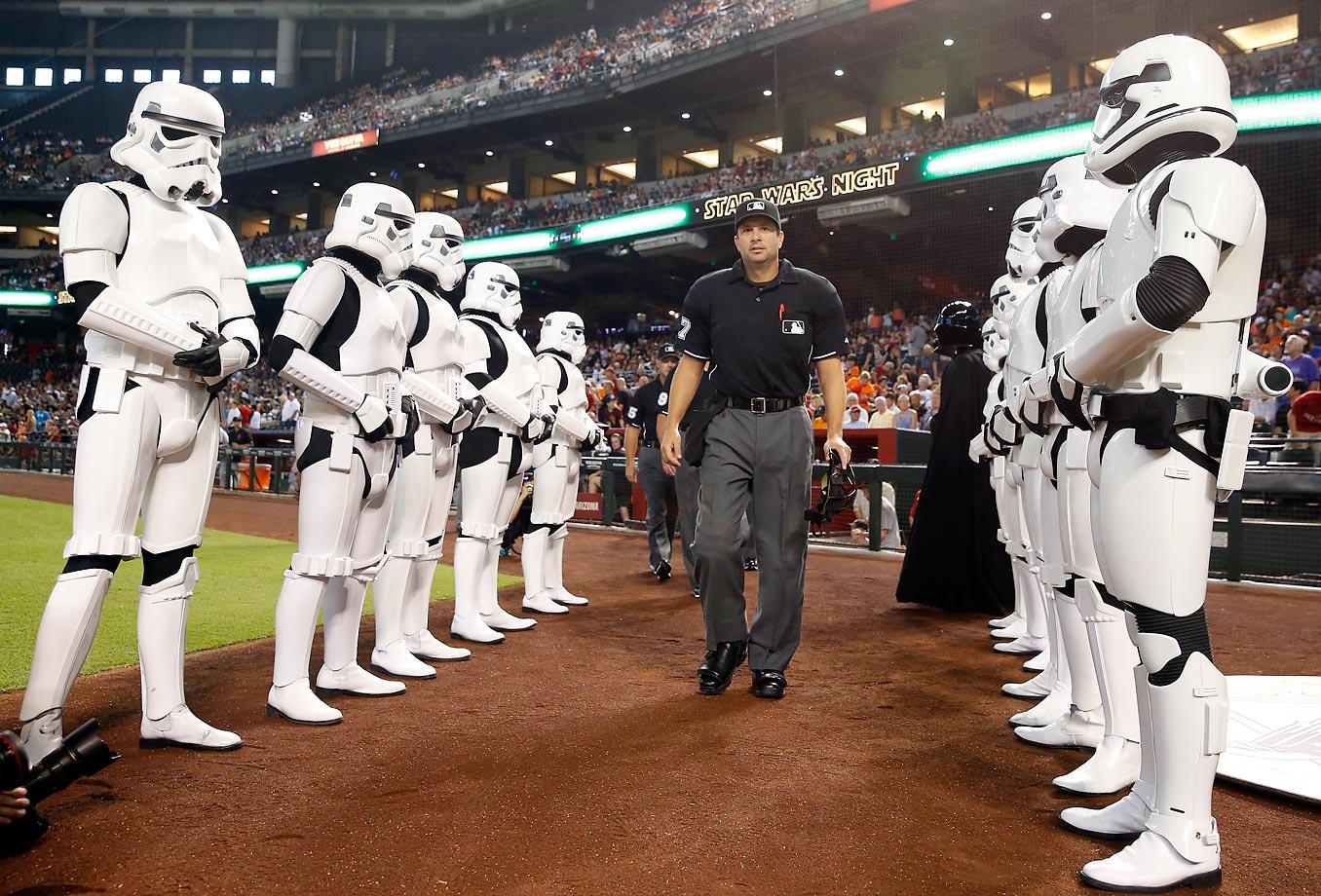 MLB umpire Jim Reynolds walks out to the field before a baseball game between the Arizona Diamondbacks and the San Francisco Giants on Star Wars night.
