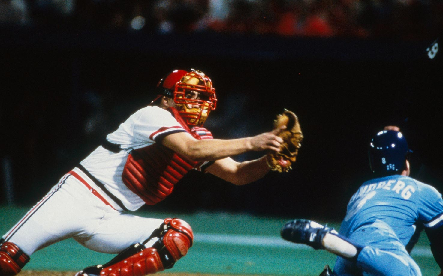 Cardinals catcher Darrell Porter reaches to tag Jim Sundberg.