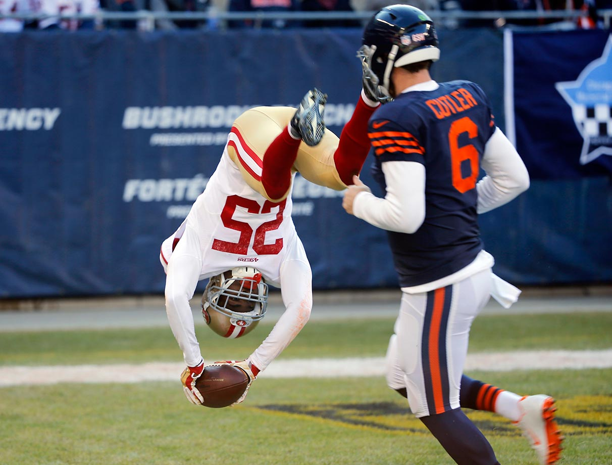 Jimmie Ward of the San Francisco 49ers dives to the end zone for a touchdown after intercepting a pass against the Bears.