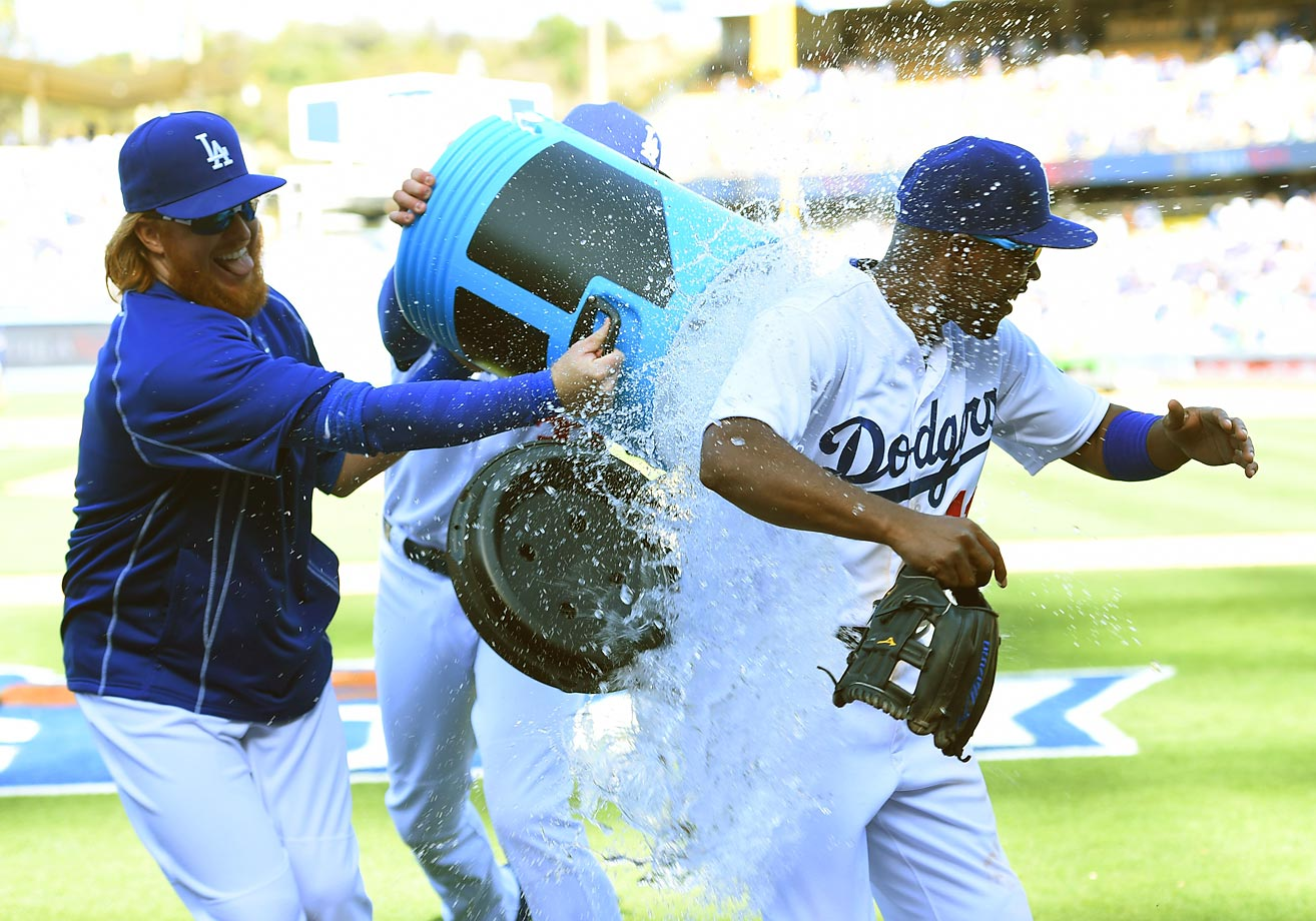 Jimmy Rollins of the Dodgers gets doused at a game against the Padres.