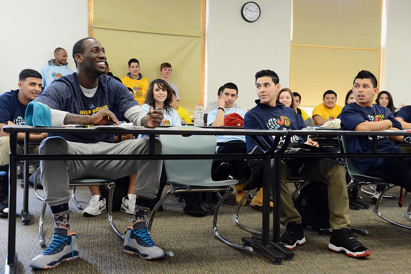 J.J. Hickson of the Denver Nuggets listens to students from North High talk about Black History Month.