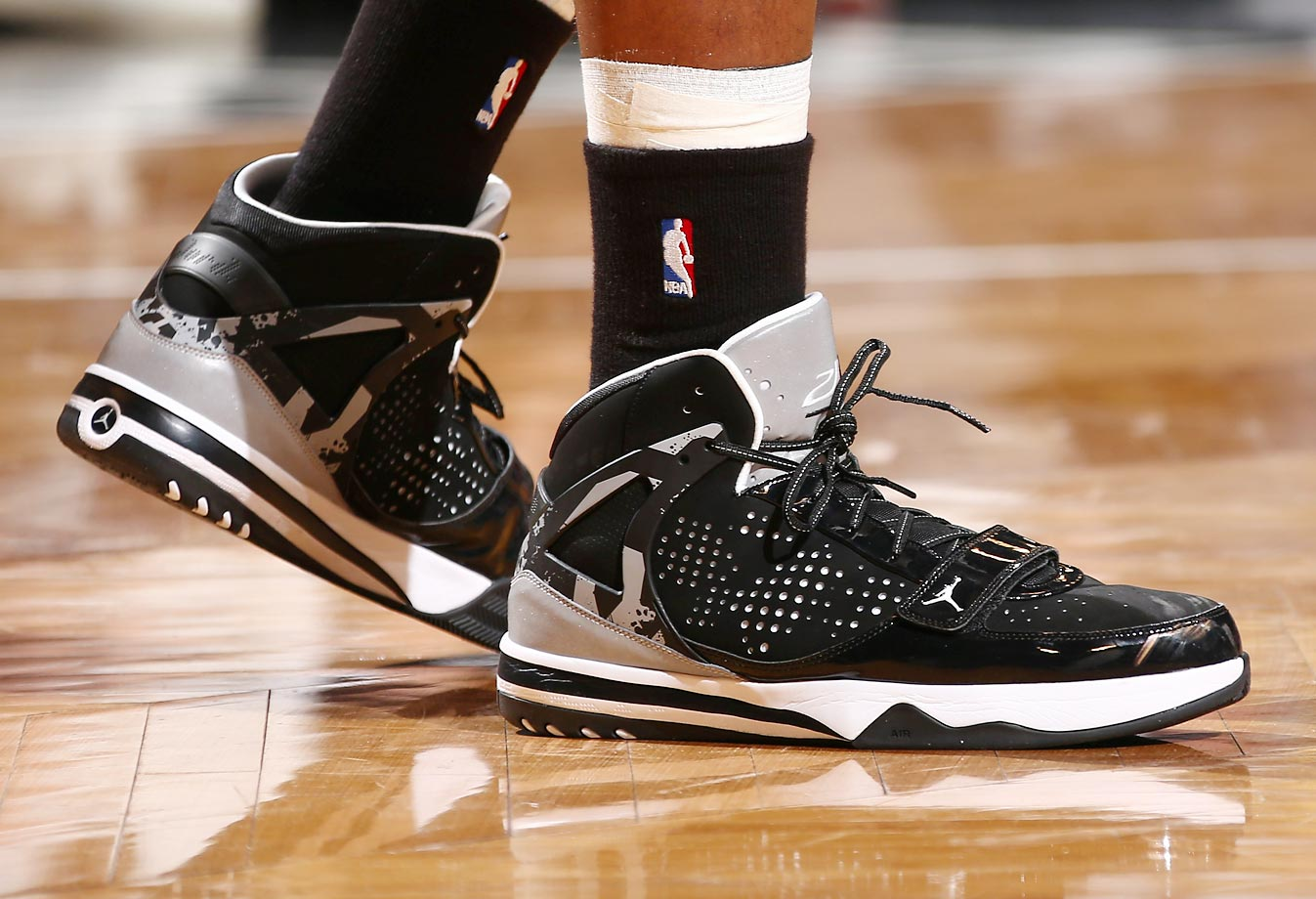 Johnson's sneakers are shown in Game Four of the Eastern Conference Semifinals against the Miami Heat on May 12, 2014