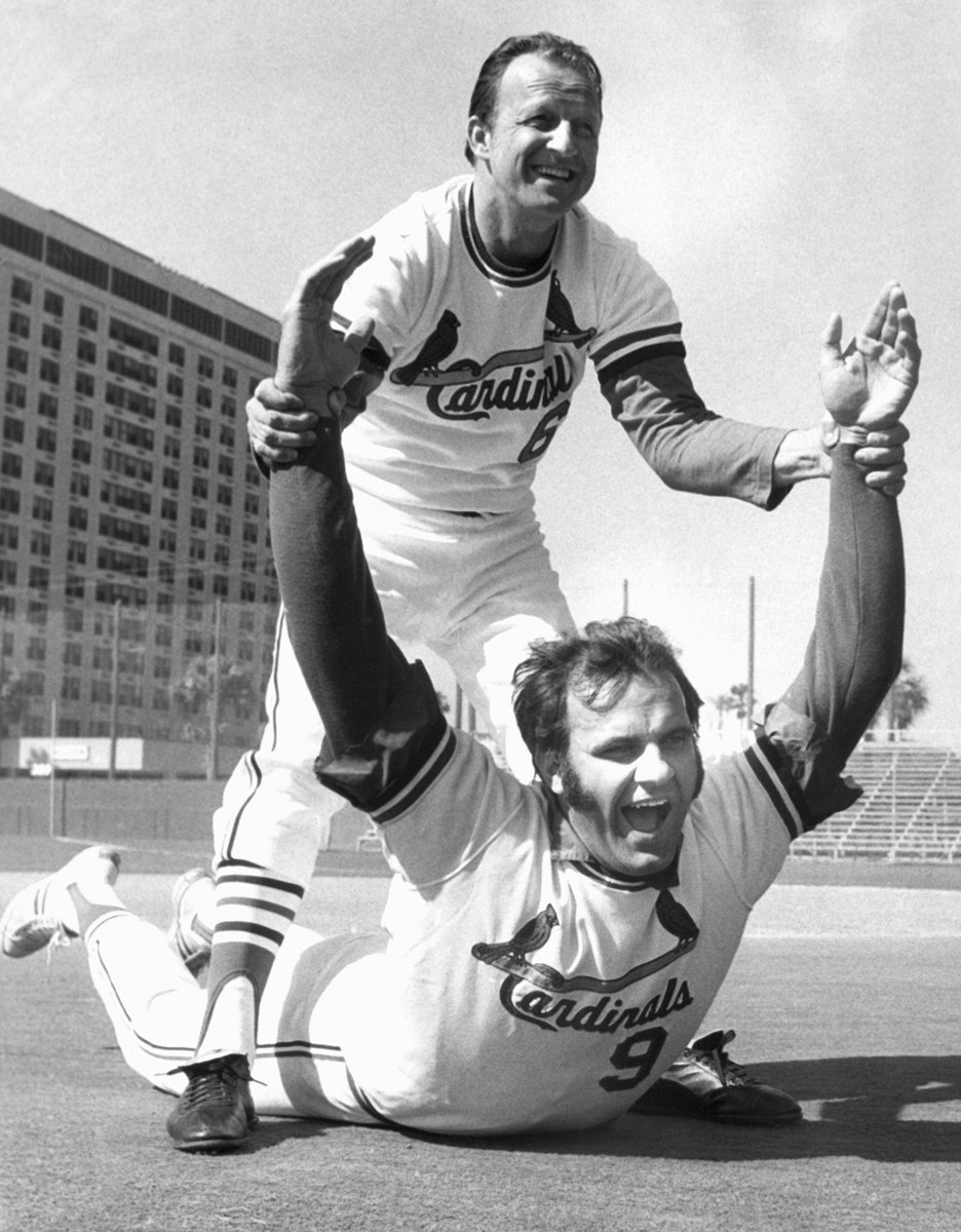 Torre gets stretched by Stan Musial in March 1972. (AP)