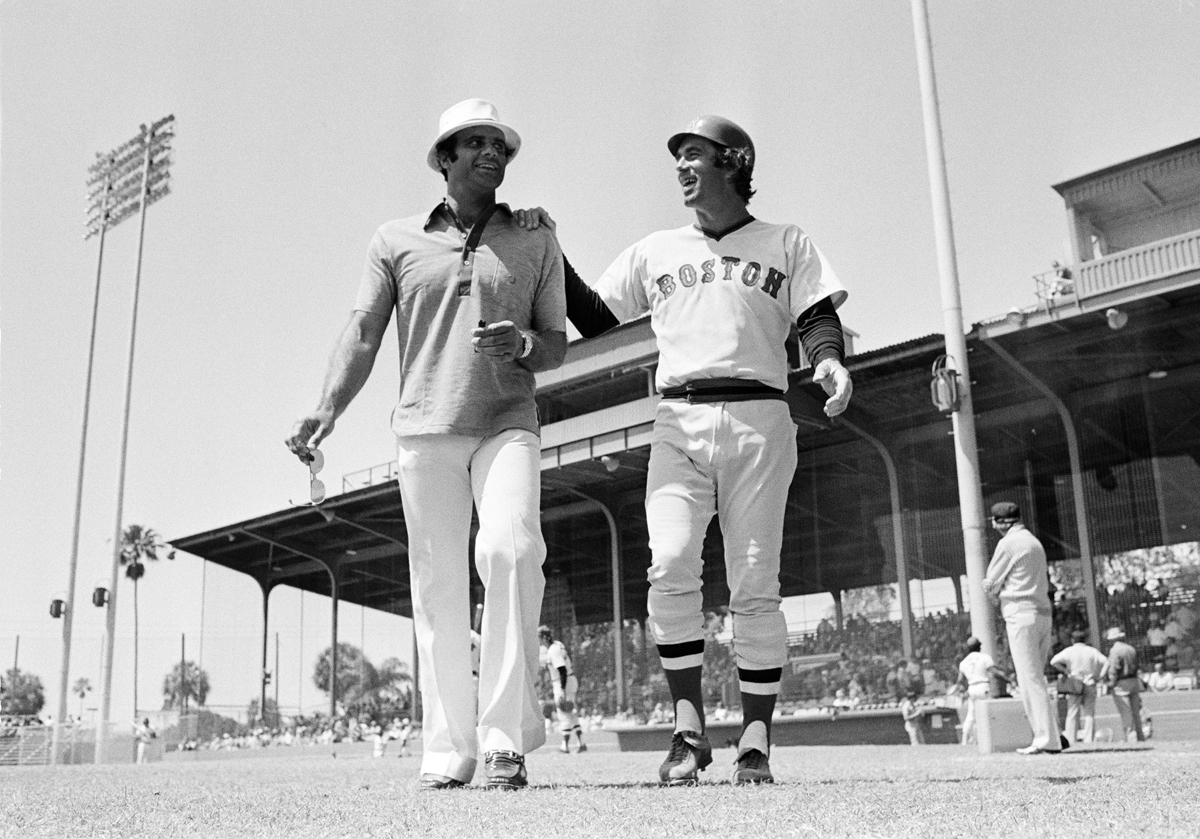 Torre and ex-teammate Tim McCarver in 1975. (AP)