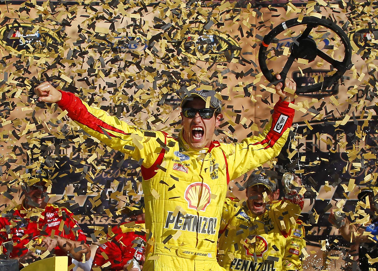NASCAR Sprint Cup Series driver Joey Logano celebrates his victory in the Hollywood Casino 400 at Kansas Speedway.