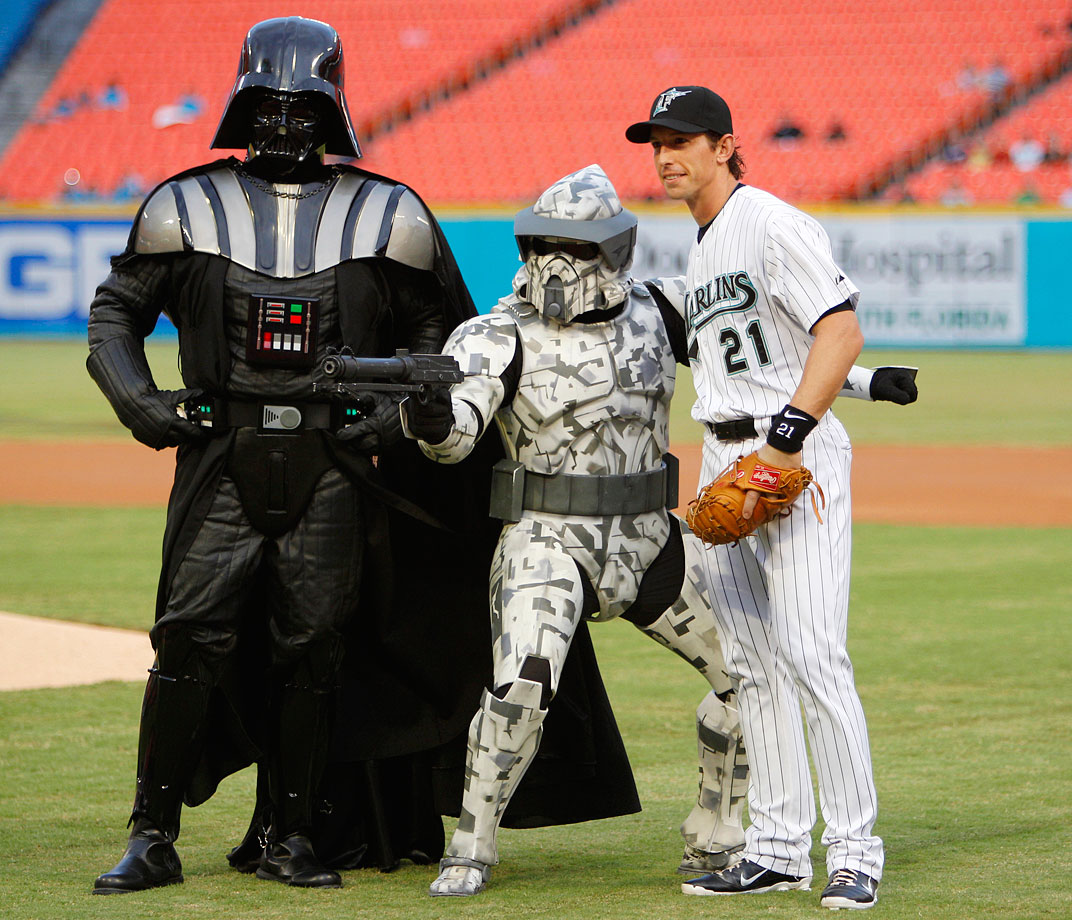 Florida Marlins catcher John Baker poses with Darth Vader and a clone trooper before the Marlins game against the Atlanta Braves on Sept. 20, 2011 at Sun Life Stadium in Miami.