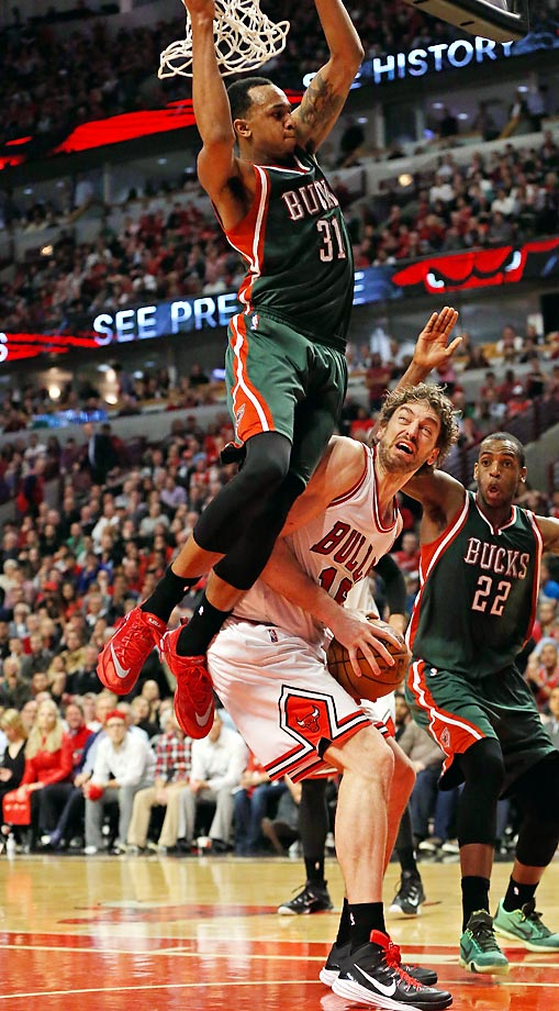Bucks' John Henson and Bulls' Pau Gasol.