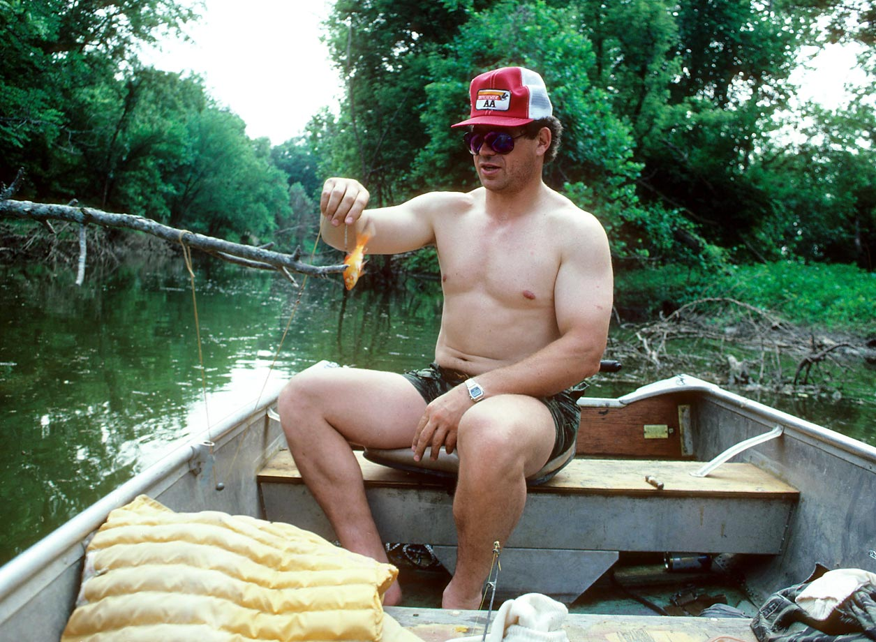 John Riggins of Washington Redskins fishing in Lawrence, Kan., in 1983.