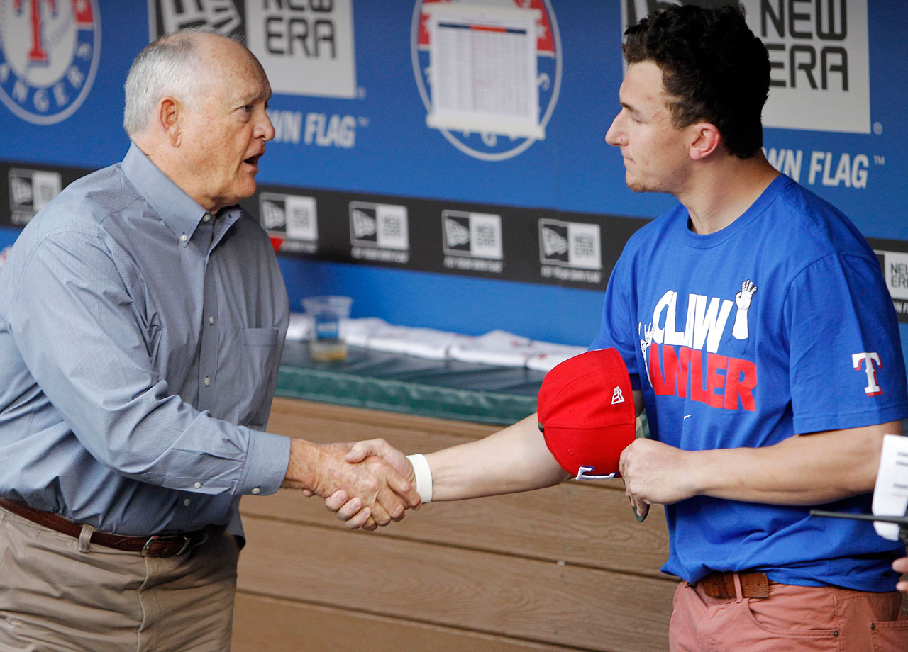 Pitching great and Texas Rangers CEO Nolan Ryan shakes hands with Johnny Manziel. The young quarterback was in Arlington to throw out the first pitch before a game on April 7, 2013.
