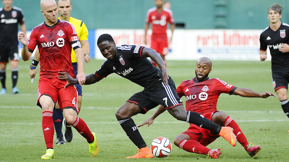 Eddie Johnson (center) netted the opening goal for D.C. United in its victory over Toronto.