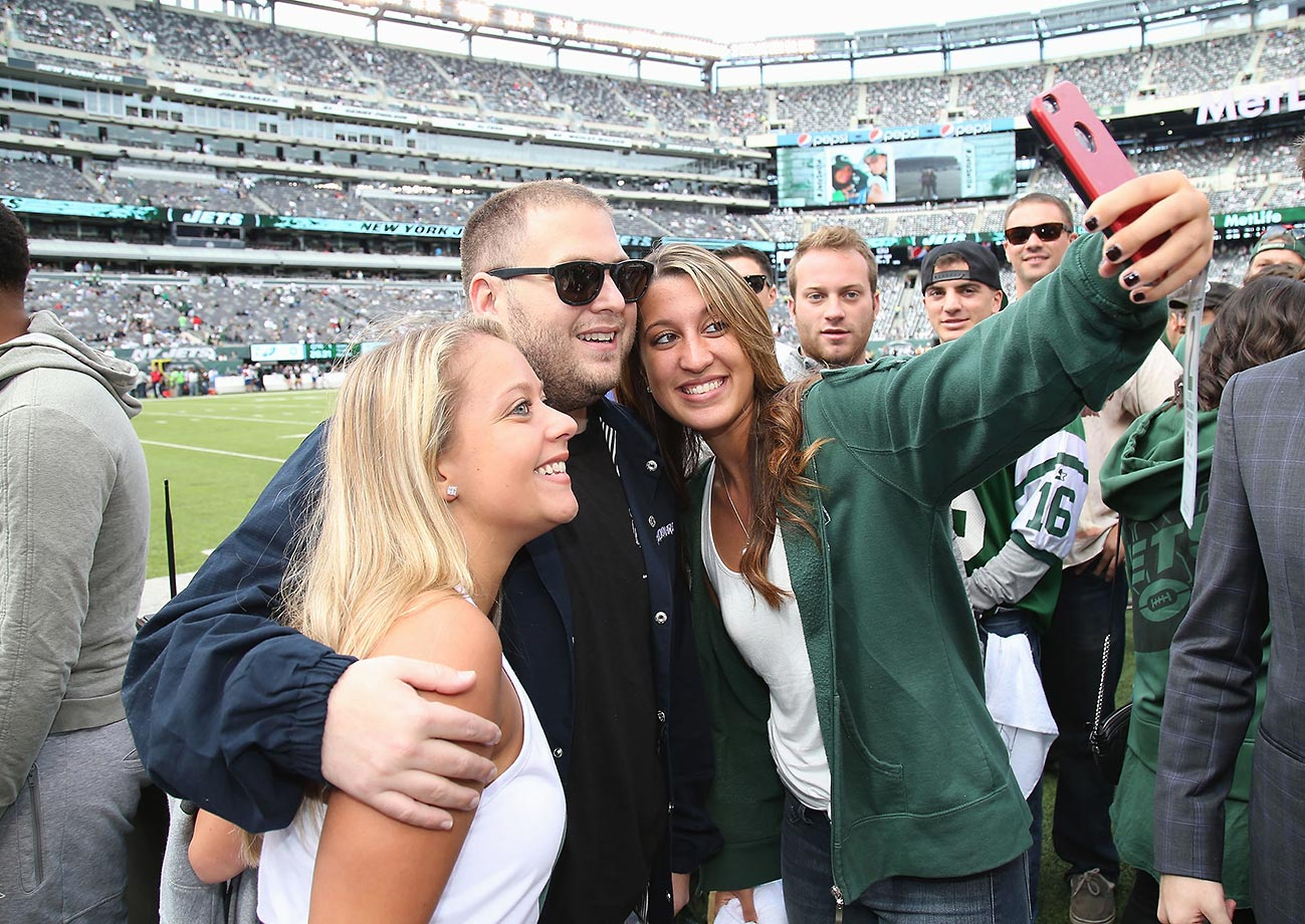 Actor Jonah Hill takes a selfie with fans at the Eagles game.