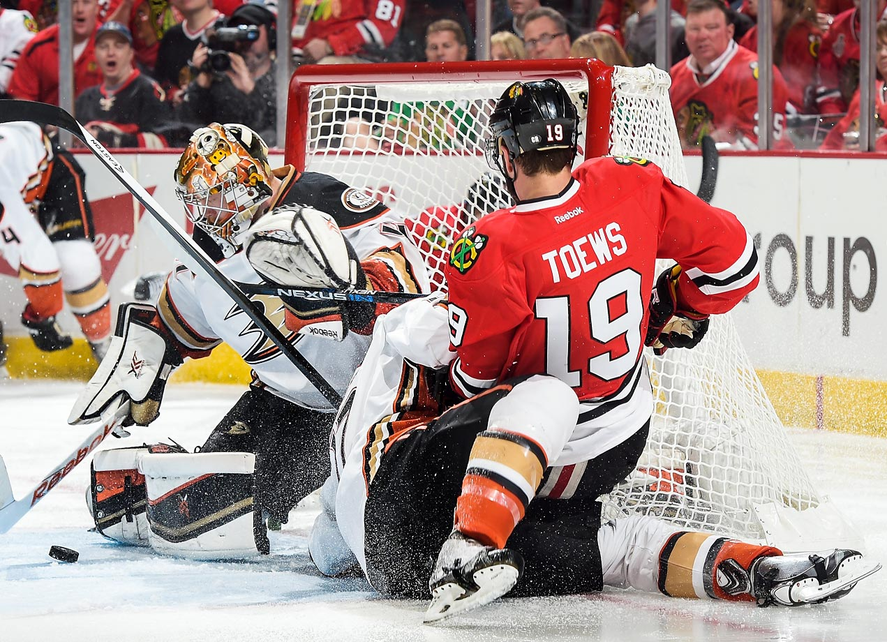Jonathan Toews of the Chicago Blackhawks falls on top of Ryan Kesler of the Anaheim Ducks in Game 4 of the Western Conference finals.