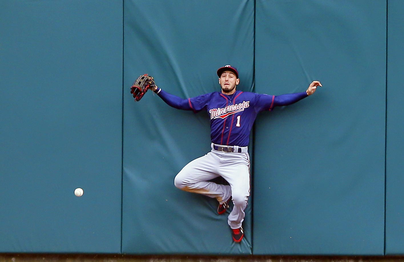 Jordan Schafer of the Minnesota Twins misplays a ball as Yoenis Cespedes of the Tigers raced to a triiple.