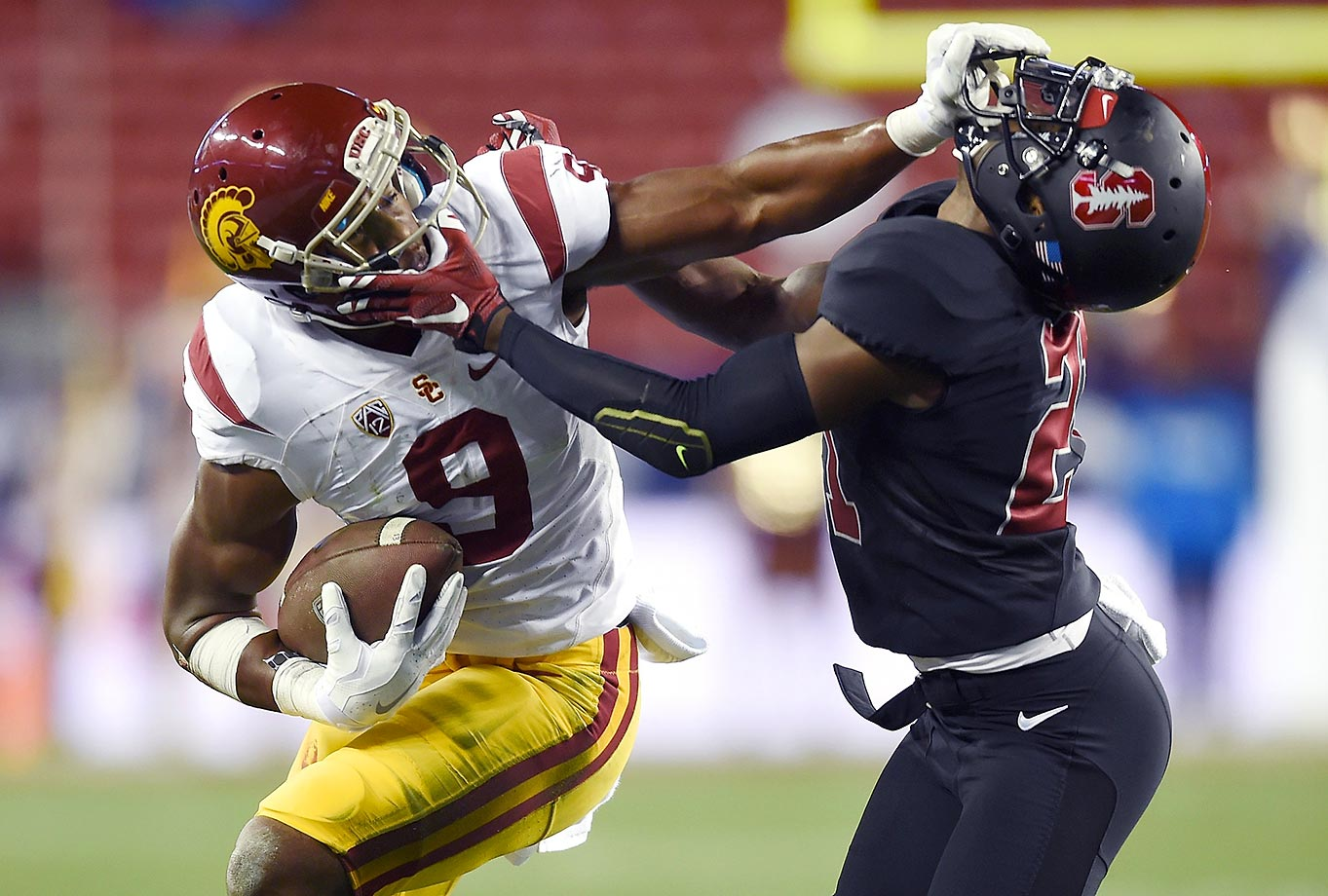 JuJu Smith-Schuster of USC stiff arms Ronnie Harris of Stanford in the Pac-12 Championship game.