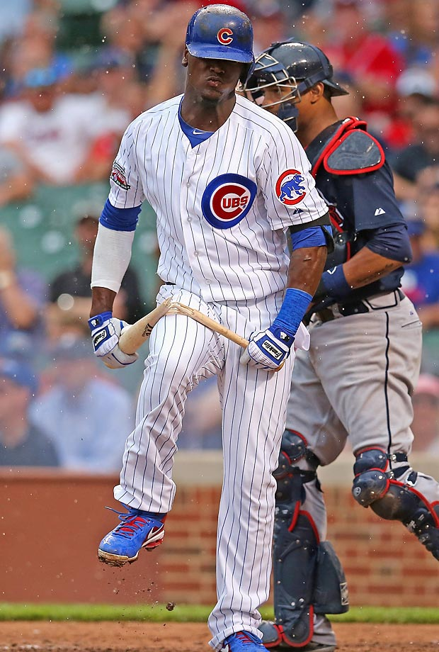 Junior Lake of the Chicago Cubs breaks his bat over his leg after striking out with the bases loaded in the 6th inning against the Atlanta Braves at Wrigley Field on July 11, 2014 in Chicago.
