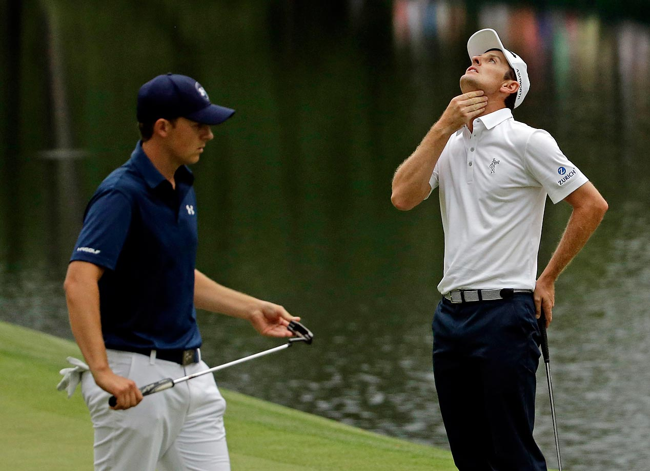 Justin Rose (standing with Jordan Spieth) misses a putt on the 16th hole during the fourth round of the Masters.