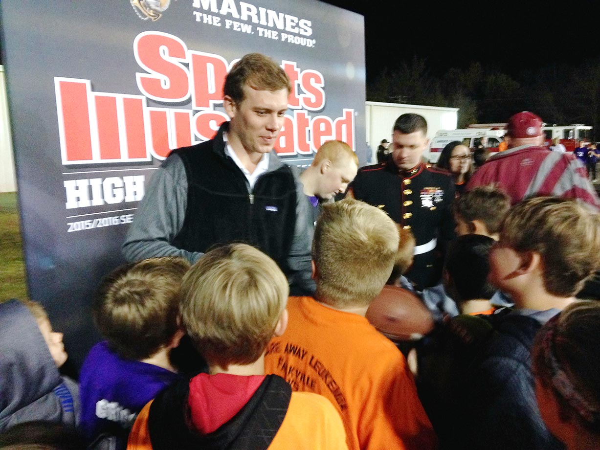 John Parker Wilson and Kane were bombarded with requests for autographs after the halftime ceremony.