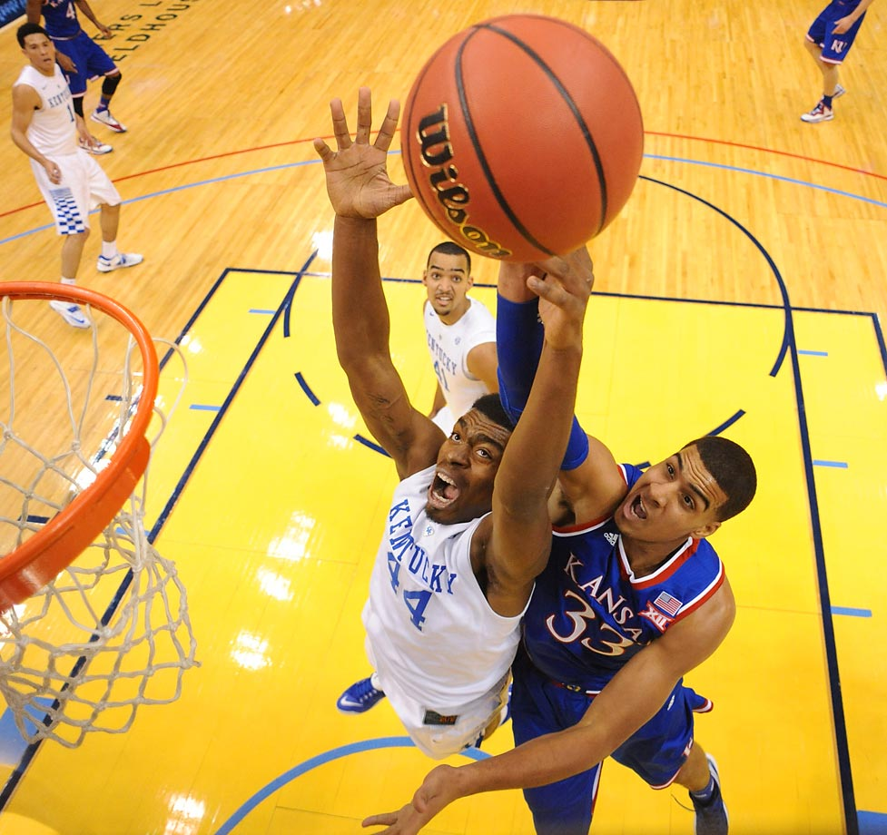 Landen Lucas of Kansas fights Dakari Johnson for the ball.