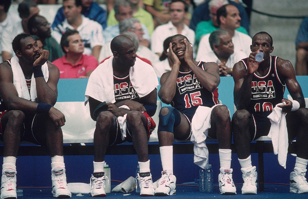 Malone joins Michael Jordan (9), Magic Johnson (15), and Clyde Drexler (10) on the bench during a 1992 Olympics game against game Puerto Rico. (John W. McDonough/SI)
