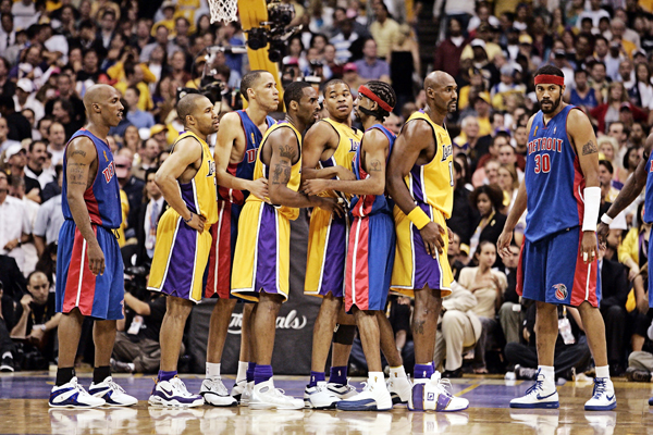 Chauncey Billups, Tayshaun Prince, Richard Hamilton and Rasheed Wallace battle for position with Derek Fisher, Kobe Bryant, Devean George, and Karl Malone during the 2004 NBA Finals. (John W. McDonough/SI)