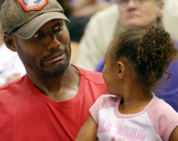 Malone jokes around with his daughter Karlee at a 2002 WNBA Game in Salt Lake City. (AP Photo/Steve C. Wilson)