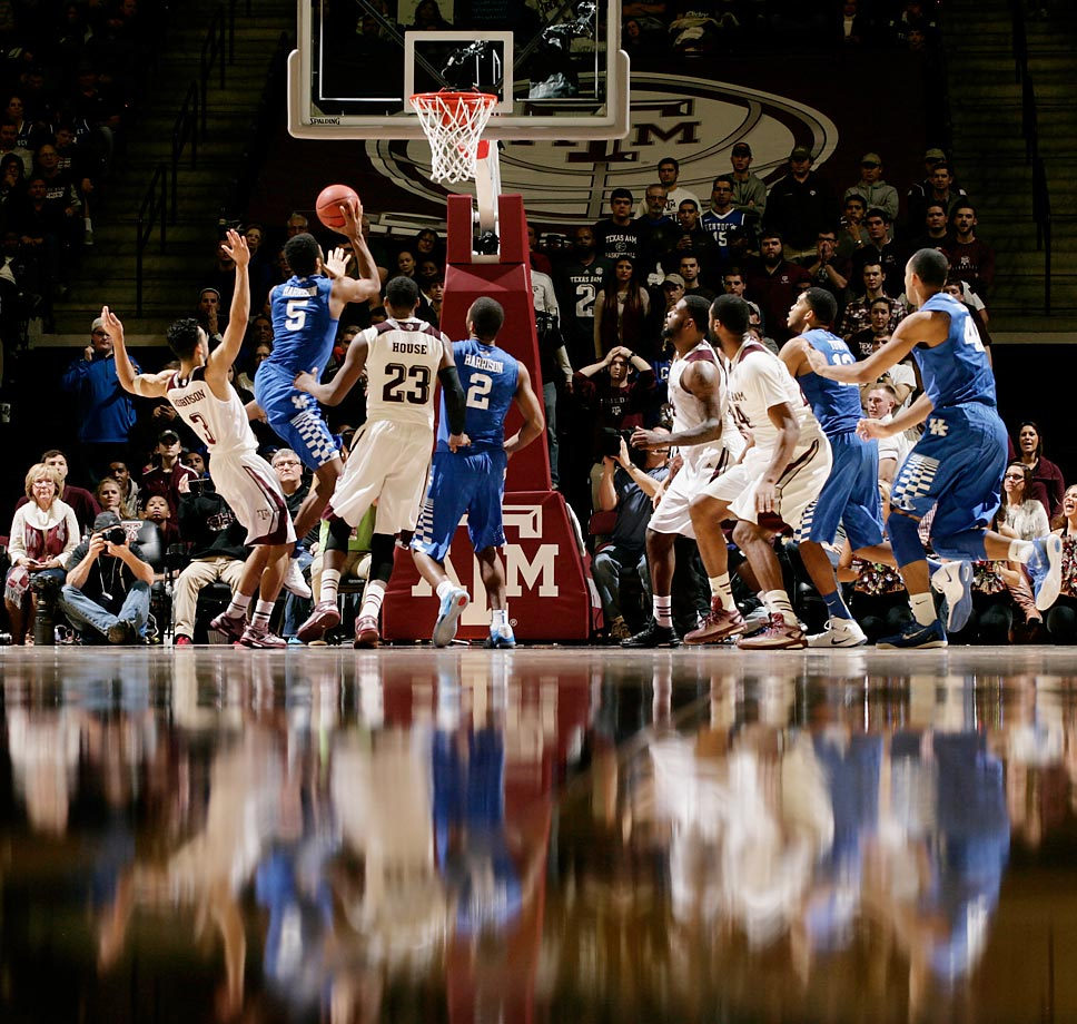 Kentucky guard Andrew Harrison attempts a shot during the Wildcats' double overtime win over Texas A&M.