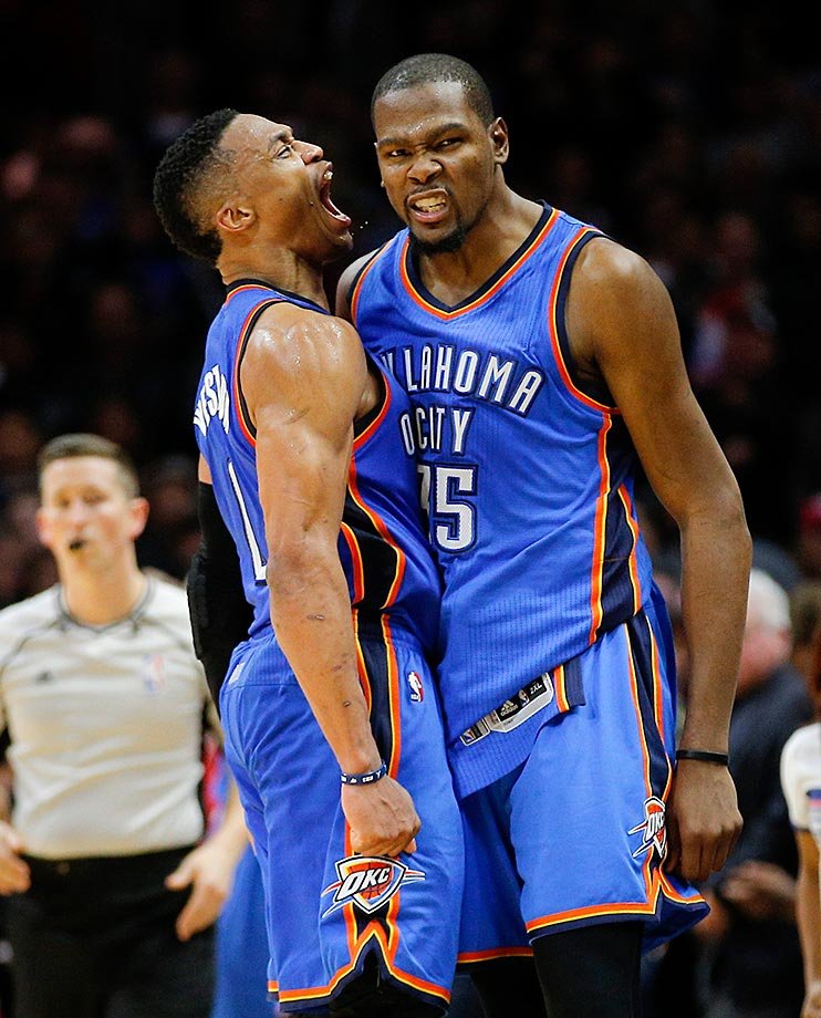 Kevin Durant and Russell Westbrook of the Oklahoma City Thunder celebrate their team's 100-99 win over the Los Angeles Clippers.