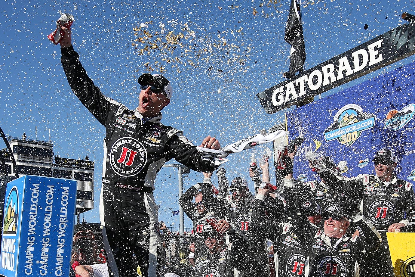 Kevin Harvick celebrates in victory lane after winning the NASCAR Sprint Cup Series CampingWorld.com 500 at Phoenix International Raceway.