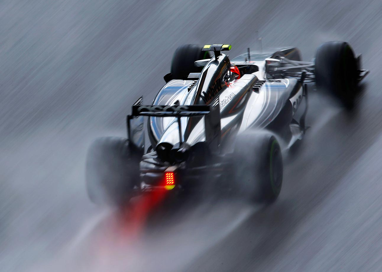 Kevin Magnussen drives through rain during qualifying for the Belgian Grand Prix at Circuit de Spa, Belgium.