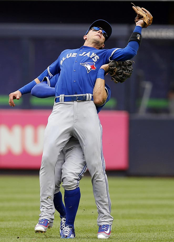 Troy Tulowitzki of the Toronto Blue Jays collides with center fielder Kevin Pillar at Yankee Stadium.