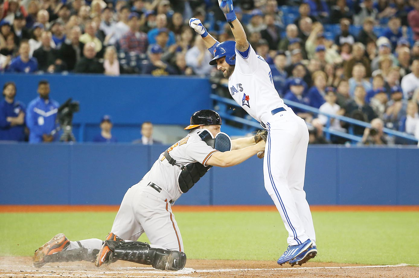 Kevin Pillar of the Blue Jays is tagged out at home by Ryan Lavarnway.
