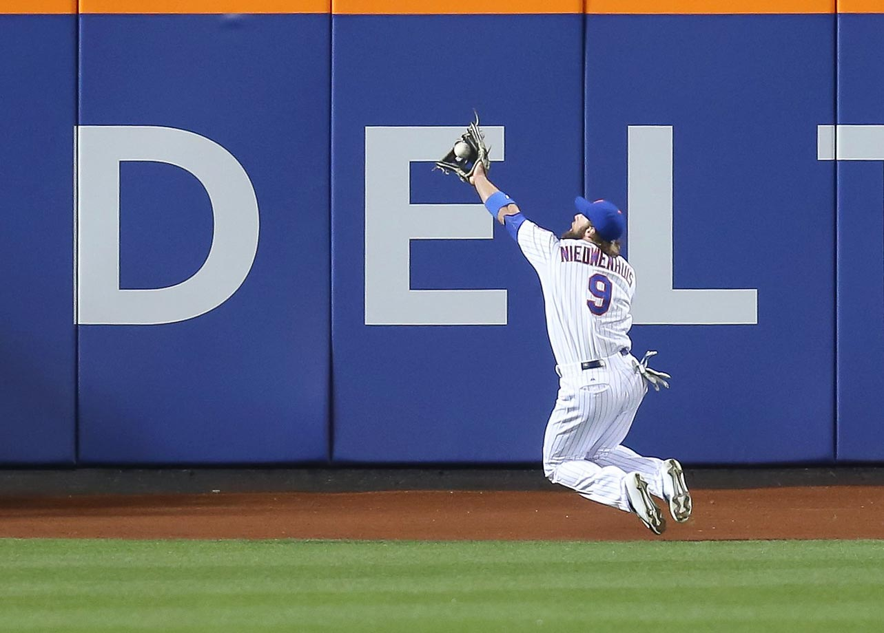 Kirk Nieuwenhuis makes a diving back-handed catch against the Phillies at Citi Field.
