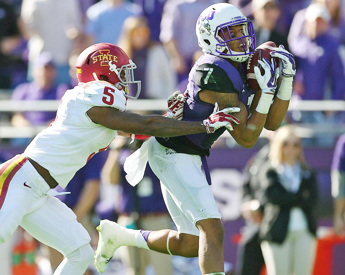 Kolby Listenbee of TCU makes a catch against Kamari Cotton-Moya of Iowa State.