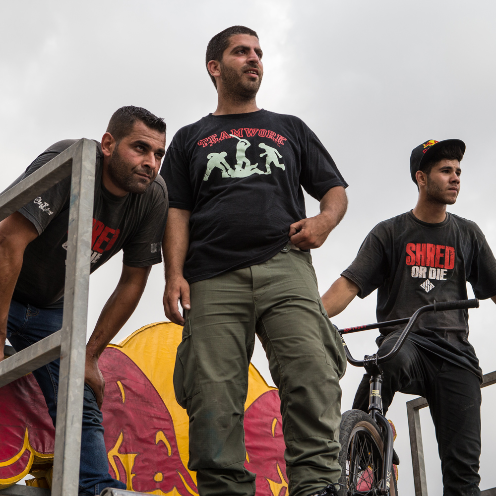 Beirut's pioneering inline skaters, Hady Basha and Hani Tamim, check out the action with Walid Kassem during Urban Culture in Beirut, Lebanon on Saturday, June 7, 2014.
