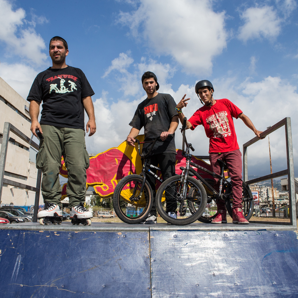One of Beirut's pioneering inline skaters, Hani Tamim, scopes the action with Walid Kassem, Lebanon's Top Street and Park BMXer, and Ahmed Issawi, Lebanon's Top Flat Land BMXer, members of team Shred or Die, during Urban Culture in Beirut, Lebanon on Saturday, June 7, 2014.