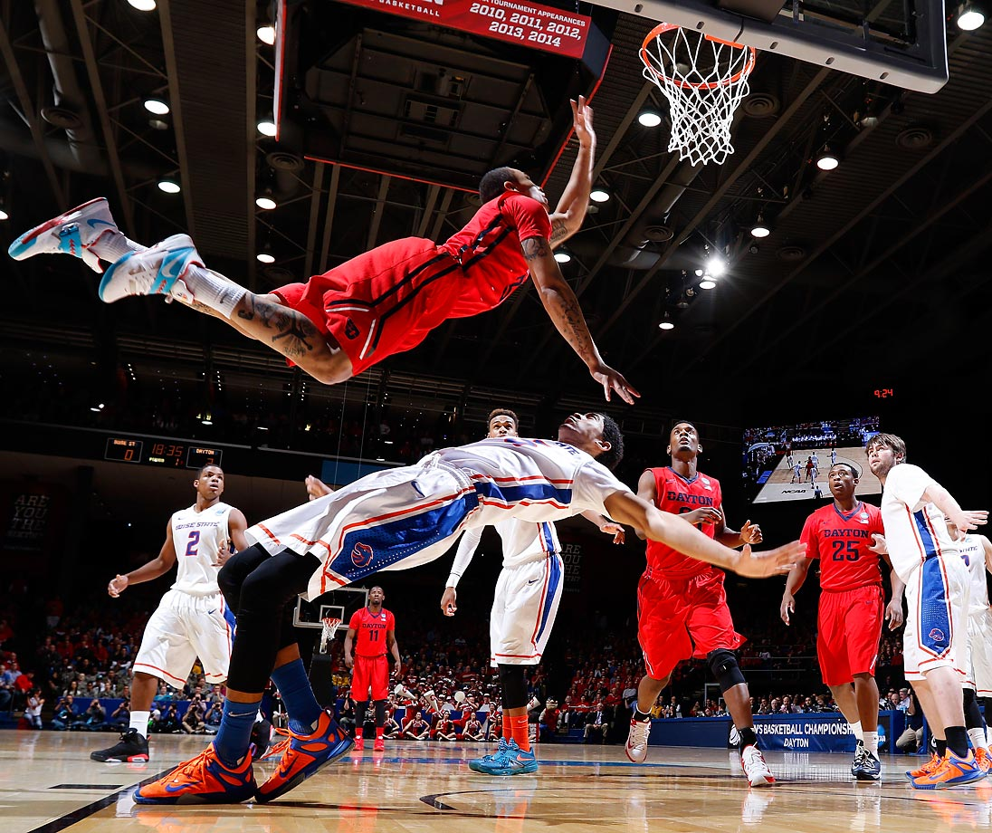 Kyle Davis of the Dayton Flyers stays focused on the basket after contact with Boise State's Chandler Hutchison.