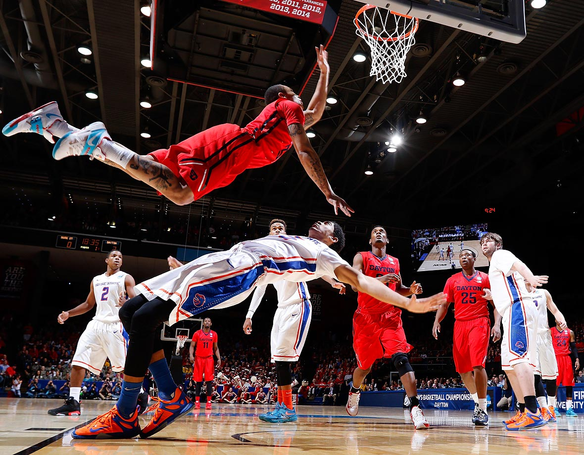 Kyle Davis of the Dayton Flyers goes to the basket against Chandler Hutchison of the Boise State Broncos during the first round of the 2015 NCAA tournament.