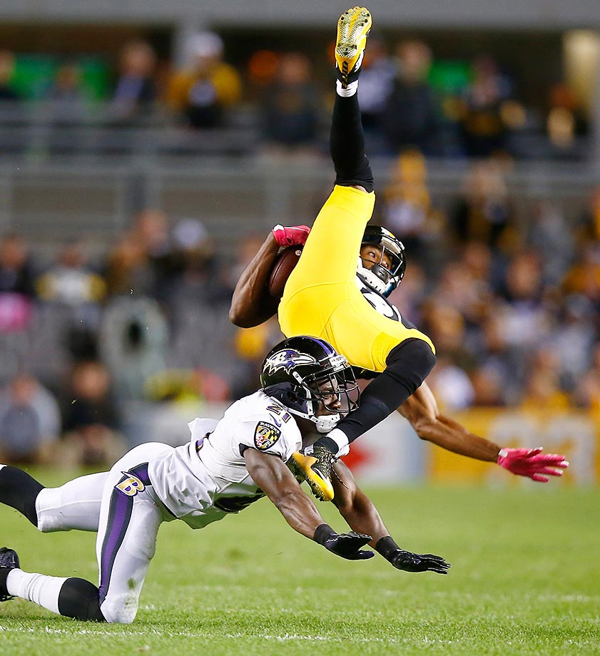 Lardarius Webb of the Baltimore Ravens tackles Darrius Heyward-Bey of the Steelers after making a catch in the 4th quarter.