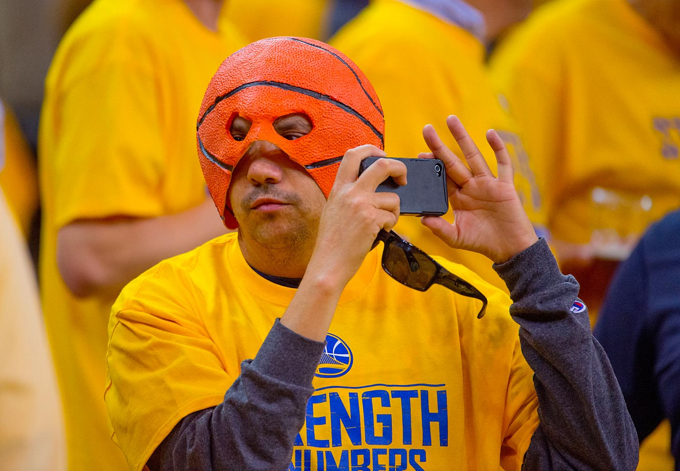 One Golden State Warriors fan captures a moment before Game 1 of the 2015 NBA Finals on June 4.